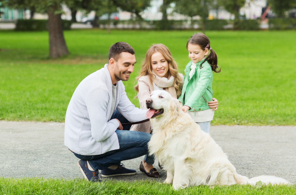 Family with golden retriever